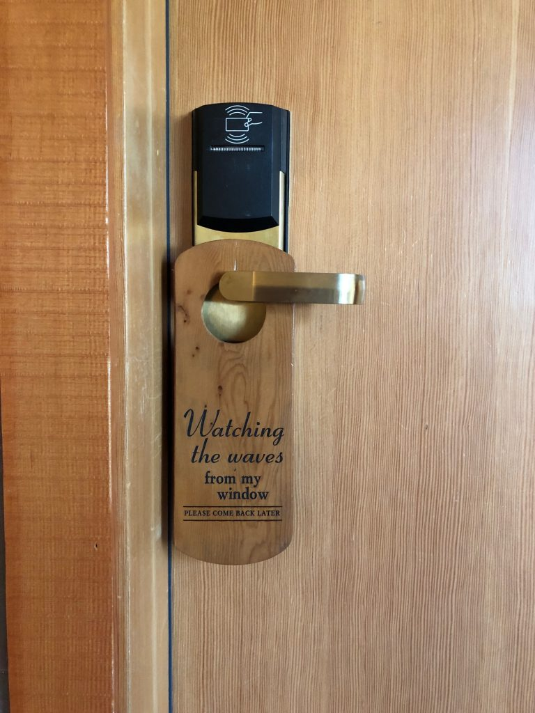 The Wick Inn watching the waves door hanger