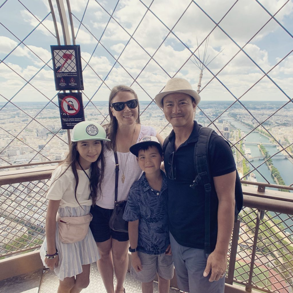 Family photo at the top of the Eiffel Tower