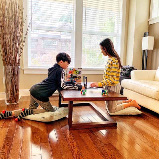 Kids playing Rubik's Race